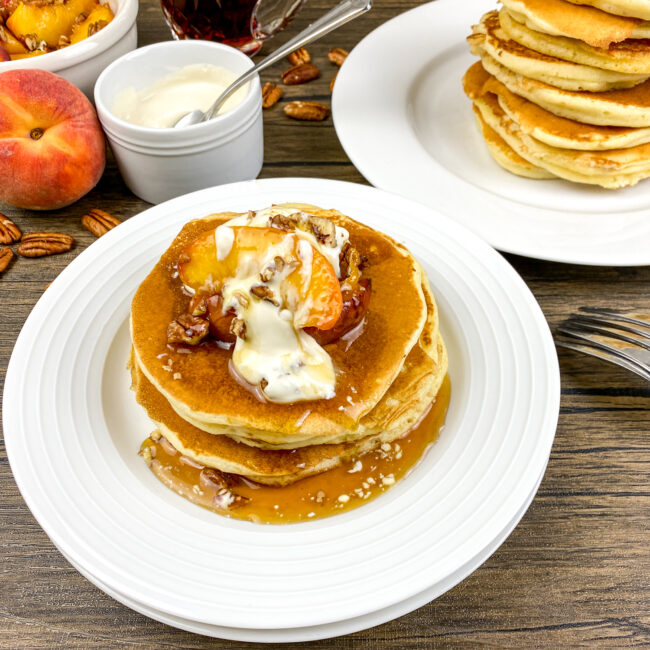Buttermilk Pancakes with Warm Maple Peaches and Cream | Monthly Kitchen-Tested Recipes